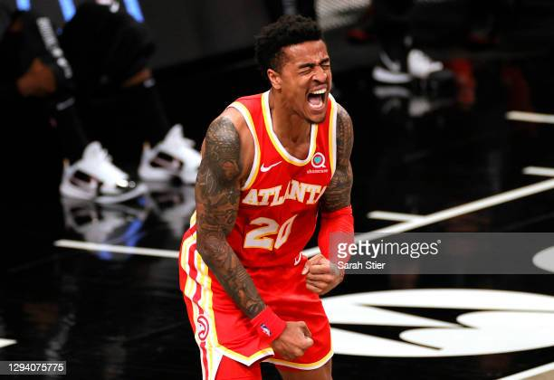 John Collins of the Atlanta Hawks reacts after scoring during the second half against the Brooklyn Nets at Barclays Center on January 01, 2021 in the...