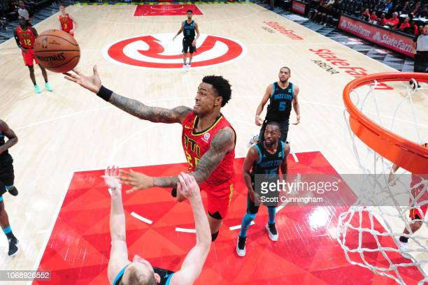 John Collins of the Atlanta Hawks rebounds the ball against the Charlotte Hornets on November 25 2018 at State Farm Arena in Atlanta Georgia NOTE TO...