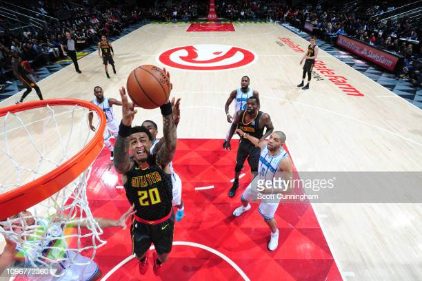 John Collins of the Atlanta Hawks rebounds the ball against the Charlotte Hornets on February 9 2019 at State Farm Arena in Atlanta Georgia NOTE TO...