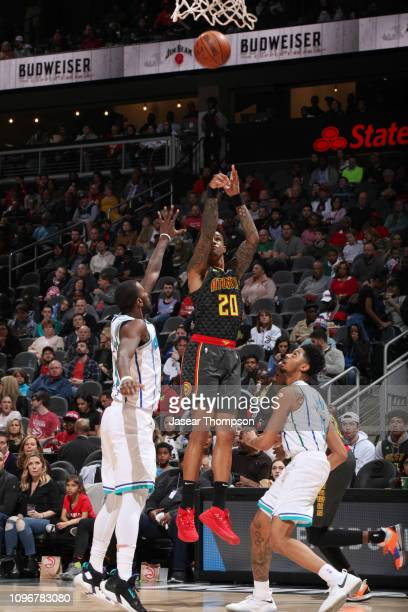 John Collins of the Atlanta Hawks shoots the ball against the Charlotte Hornets on February 9 2019 at State Farm Arena in Atlanta Georgia NOTE TO...