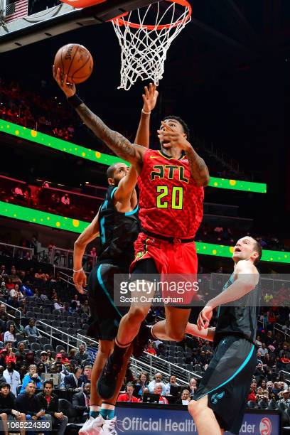 John Collins of the Atlanta Hawks shoots the ball against the Charlotte Hornets on November 25 2018 at State Farm Arena in Atlanta Georgia NOTE TO...