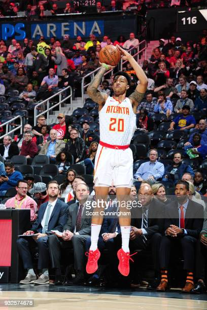 John Collins of the Atlanta Hawks shoots the ball against the Charlotte Hornets on March 15 2018 at Philips Arena in Atlanta Georgia NOTE TO USER...