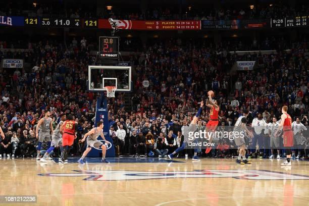 John Collins of the Atlanta Hawks shoots the game winner against the Philadelphia 76ers on January 11 2019 at the Wells Fargo Center in Philadelphia...