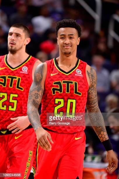 John Collins of the Atlanta Hawks smiles during a game against the Phoenix Suns on February 2 2019 at Talking Stick Resort Arena in Phoenix Arizona...
