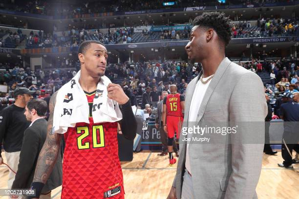 John Collins of the Atlanta Hawks talks with Jaren Jackson Jr #13 of the Memphis Grizzlies after the game on March 7 2020 at FedExForum in Memphis...