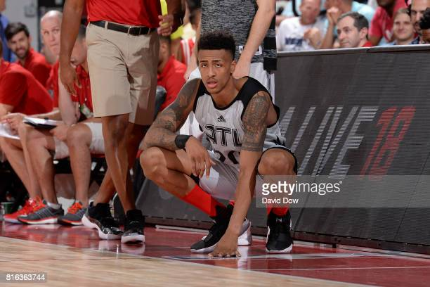 John Collins of the Atlanta Hawks watches from the sidelines against the Brooklyn Nets during the 2017 Las Vegas Summer League on July 7 2017 at the...