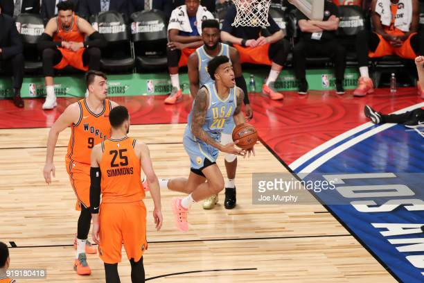 John Collins of the USA Team goes to the basket against the World Team during the Mountain Dew Kickstart Rising Stars Game during AllStar Friday...