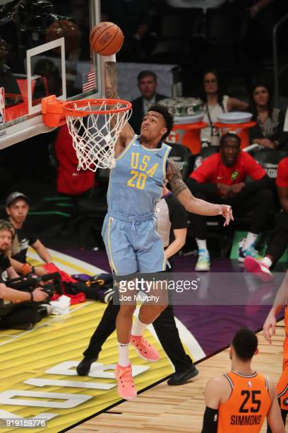 John Collins of the USA Team goes up for a dunk against the World Team during the Mountain Dew Kickstart Rising Stars Game during AllStar Friday...