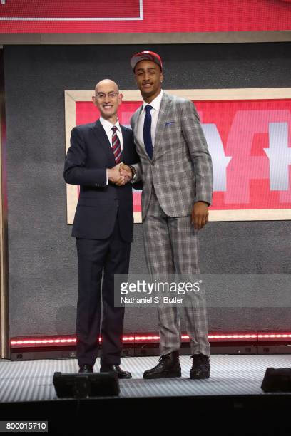 John Collins shakes hands with NBA Commissioner Adam Silver after being selected number nineteen overall by the Atlanta Hawks during the 2017 NBA...