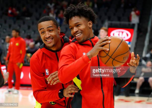 John Collins warms up with Brandon Goodwin of the Atlanta Hawks prior to an NBA game against the Philadelphia 76ers at State Farm Arena on January 30...