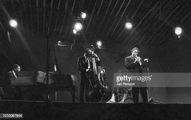 John Coltrane with McCoy Tyner Jimmy Garrison and Elvin Jones performing ComblainLaTour Belgium 1965 American jazz saxophonist and composer
