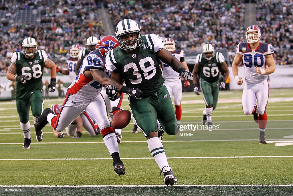 John Conner #38 of the New York Jets looses the ball after scoring a touchdown against the defense of Donte Whitner #20 of the Buffalo Bills at New Meadowlands Stadium on January 2, 2011 in East Rutherford, New Jersey.