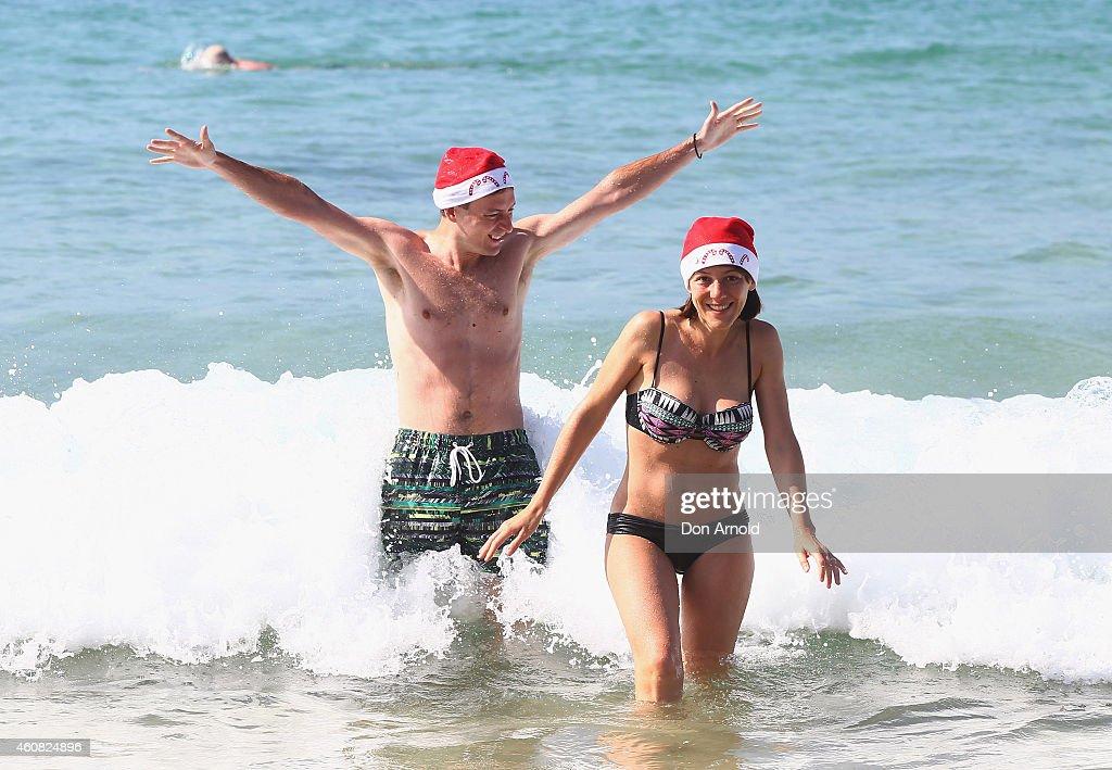 John Consuela and Marta Consuela of Como, Italy, frolic in the water at Bondi Beach on December 25, 2014 in Sydney, Australia. Bondi Beach is a popular tourist destination on Christmas Day.