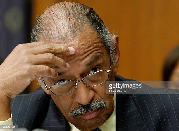 John Conyers Jr chairman of the House Judiciary Committee listens to comments a hearing on Capitol Hill March 21 2007 in Washington DC A showdown...