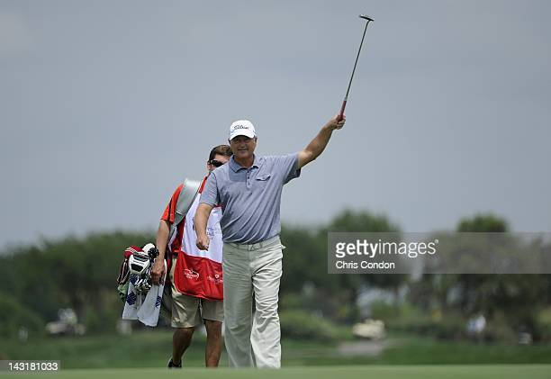 John Cook celebrates an eagle on the the 18th green during the first round round of the Legends Division at the Liberty Mutual Legends of Golf at The...