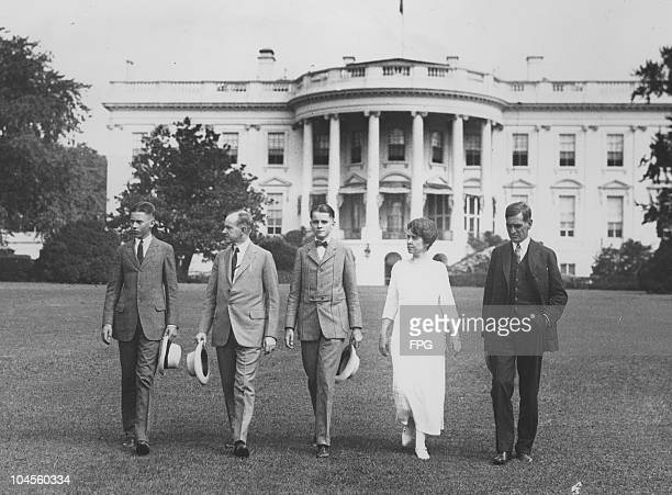 John Coolidge former United States President Calvin Coolidge Calvin Coolidge Jr former First Lady Grace Coolidge and George Christian looking over...