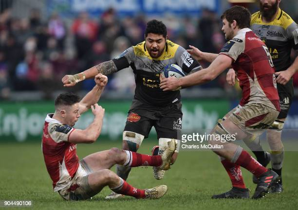 John Cooney and Iain Henderson of Ulster and Afa Amosa of La Rochelle during the European Rugby Champions Cup match between Ulster Rugby and La...