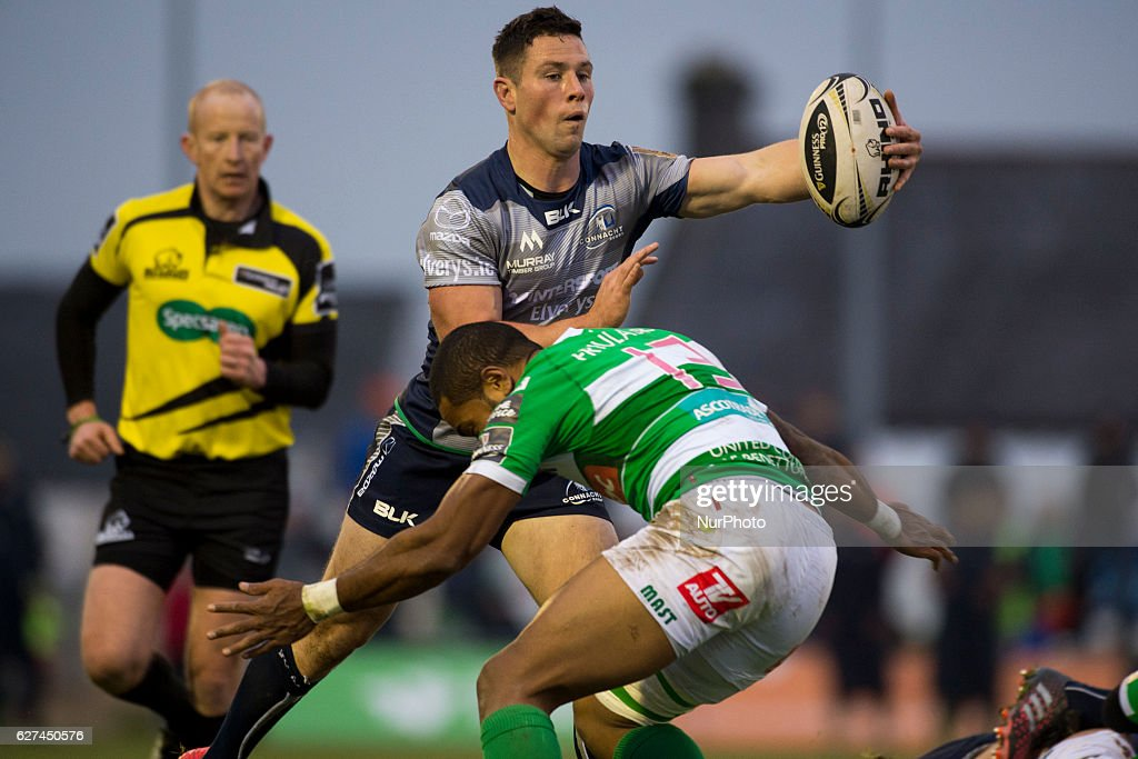 John Cooney of Connacht pictured with the ball and Michael Tagicakibau of Benetton during the Guinness PRO12 Round 10 match between Connacht Rugby and Benetton Treviso at the Sportsground in Galway, Ireland on December 3, 2016