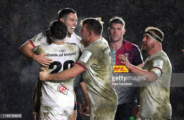 John Cooney of Ulster celebrates scoring his sides third a try with teammates during the Heineken Champions Cup Round 4 match between Harlequins and...