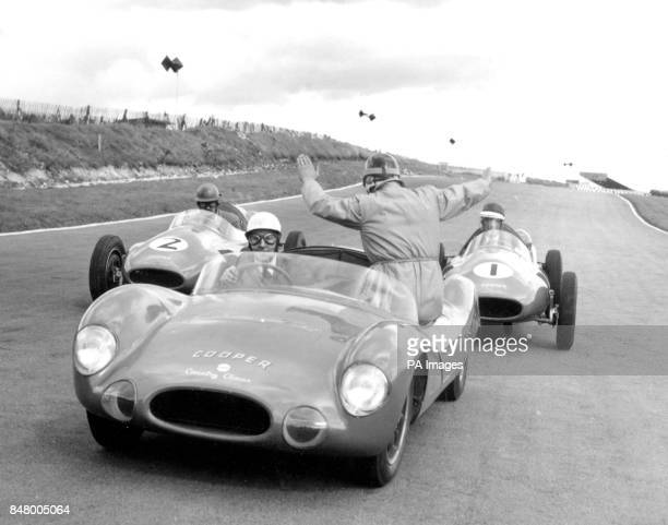 John Cooper back to camera instructs from a Cooper car driven by Les Leston as two trainee racing drivers also in Cooper cars Major Arthur Mallock...