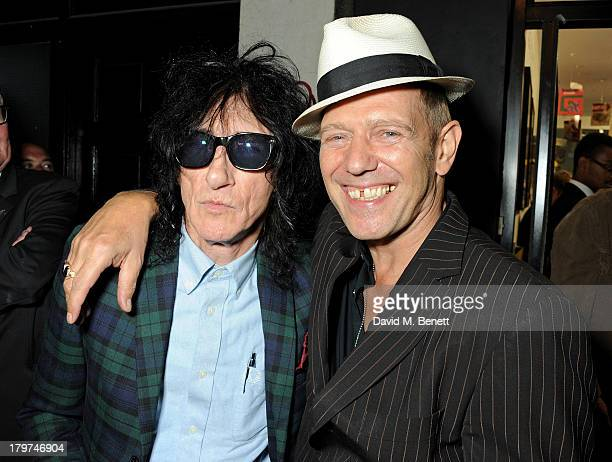 John Cooper Clarke and Paul Simonon attend the launch of 'Black Market Clash' an exhibition of personal memorabilia and items curated by original...