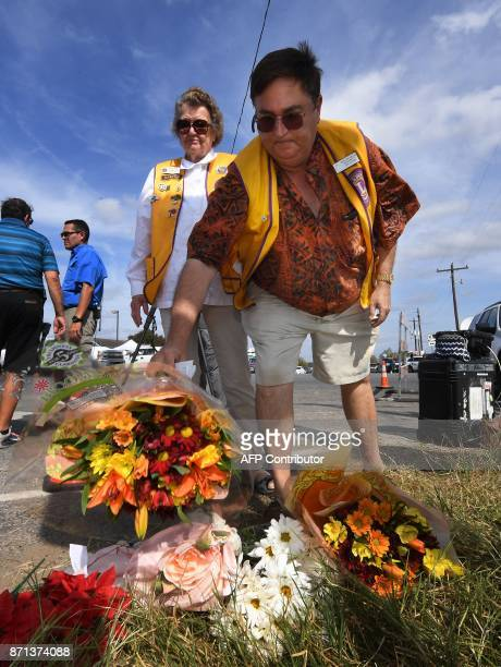 John Cooper places flowers at a memorial outside the First Baptist Church after a mass shooting that killed 26 people in Sutherland Springs Texas on...