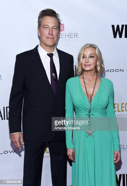 John Corbett and Bo Derek arrive at the 2019 WildAid Gala at the Beverly Wilshire Four Seasons Hotel on November 09 2019 in Beverly Hills California