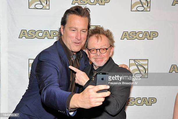 John Corbett and Paul Williams pose for a self portrait at the 50th Annual ASCAP Country Music Awards at the Gaylord Opryland Hotel on October 29...