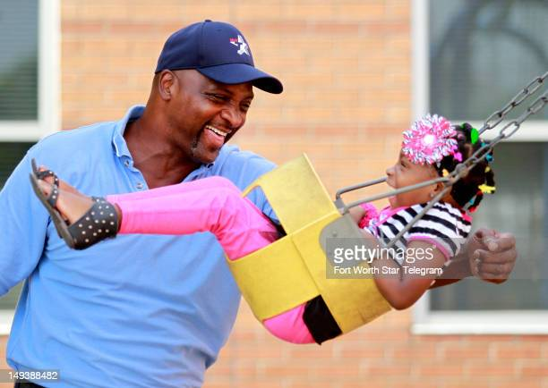John Corker plays with his daughter Alexis at the Salvation Army on July 16 in Fort Worth Texas Corker once a brash AllAmerican linebacker who set...