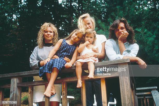John Cougar Mellencamp poses with his daughters Michele Teddi Jo and Justice and his wife Victoria