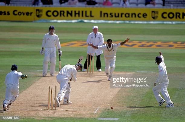 John Crawley of England is bowled by Muttiah Muralitharan of Sri Lanka for 14 runs in the second innings of the only Test match between England and...