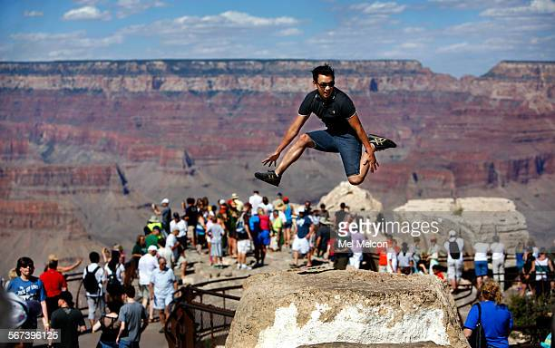 John Cristi from San Jose does his self described Jump Shot pose with the Grand Canyon in the backdrop as his wife Normeleen takes his photograph at...