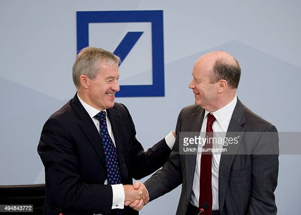 John Cryan and Juergen Fitschen CEO's of Deutsche Bank AG during the press conference in Frankfurt In the background the German Bank Logo