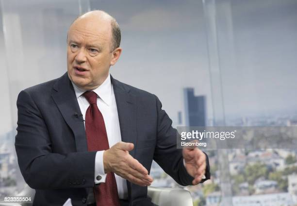 John Cryan chief executive officer of Deutsche Bank AG gestures while speaking during a Bloomberg Television interview at the bank's headquarters in...