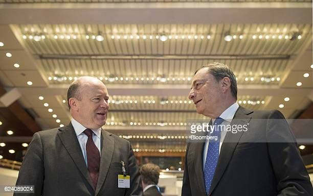 John Cryan chief executive officer of Deutsche Bank AG left speaks with Mario Draghi president of the European Central Bank during Euro Finance Week...