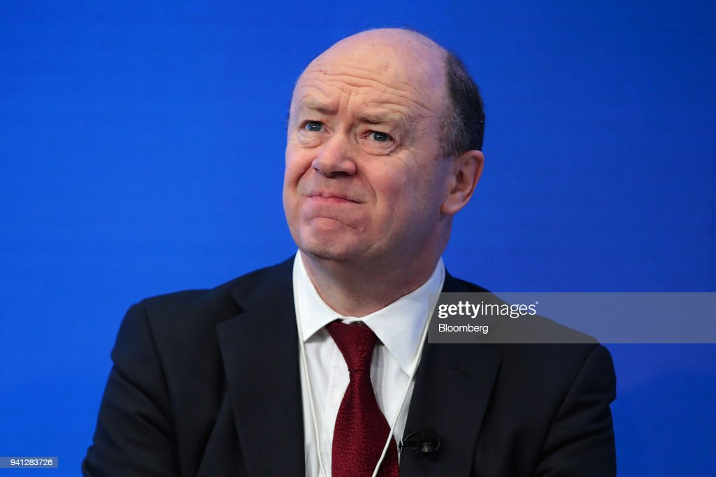 John Cryan, chief executive officer of Deutsche Bank AG, reacts during a panel session at the World Economic Forum (WEF) in Davos, Switzerland, on Tuesday, Jan. 17, 2017. Deutsche Bank AG is considering candidates to potentially replace Chief Executive Officer Cryan amid heightened tensions between him and Supervisory Board Chairman Paul Achleitner, the Times of London reported without saying where it got the information. The bank approached Richard Gnodde, the head of Goldman Sachs Group Inc.s international operations, but hes thought to have spurned the overture, the newspaper said. Deutsche Bank also considered UniCredit SpA CEO Jean Pierre Mustier and Standard Chartered Plc CEO Bill Winters, according to the report. Our editors select the best archive images for the Deutsche story. Photographer: Jason Alden/Bloomberg via Getty Images