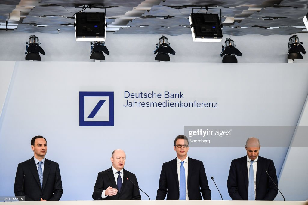 John Cryan, chief executive officer of Deutsche Bank AG, second left, speaks as he stands flanked by James von Moltke, chief financial officer of Deutsche Bank AG, left, Christian Sewing, deputy chief executive officer of Deutsche Bank AG, second right, and Marcus Schenck, deputy chief executive officer of Deutsche Bank AG, during a fourth quarter results news conference in Frankfurt, Germany, on Friday, Feb. 2, 2018. Deutsche Bank AG is considering candidates to potentially replace Chief Executive Officer Cryan amid heightened tensions between him and Supervisory Board Chairman Paul Achleitner, the Times of London reported without saying where it got the information. The bank approached Richard Gnodde, the head of Goldman Sachs Group Inc.s international operations, but hes thought to have spurned the overture, the newspaper said. Deutsche Bank also considered UniCredit SpA CEO Jean Pierre Mustier and Standard Chartered Plc CEO Bill Winters, according to the report. Our editors select the best archive images for the Deutsche story. Photographer: Andreas Arnold/Bloomberg via Getty Images