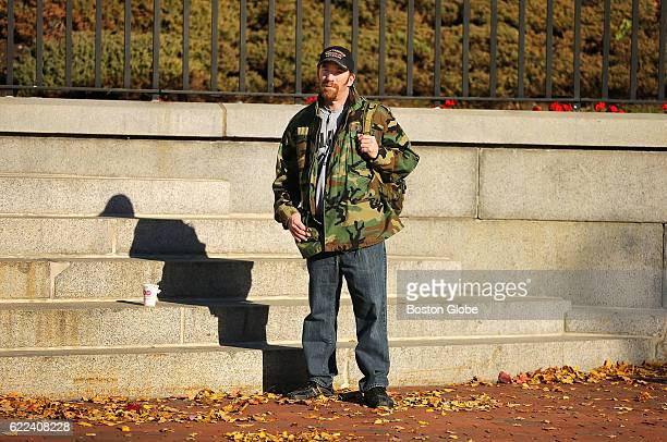 John Curran from Quincy stands by himself to watch a Veterans Day Commemoration Ceremony for the 54th Massachusetts Volunteer Regiment in front of...