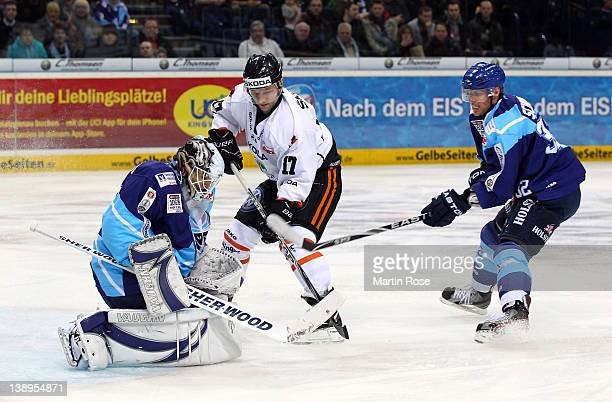 John Curry , goaltender of Hamburg makes a save on Sebastian Furchner of Wolfsburg during the DEL match between Hamburg Freezers and Grizzly Adams...