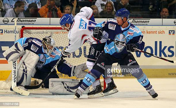 John Curry , goaltender of Hamburg saves the shot of Marcus Kink of Mannheim during the DEL match between Hamburg Freezers and Adler Mannheim at the...