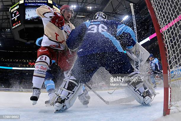 John Curry goaltender of Hamburg saves the shot of Patrick Buzas of Hannover during the DEL match between Hamburg Freezers and Hannover Scorpions at...