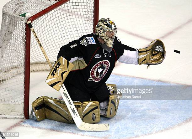 John Curry of the Wilkes-Barre/Scranton Penguins makes a glove save against the Chicago Wolves during the Calder Cup Finals on June 10, 2008 at the...