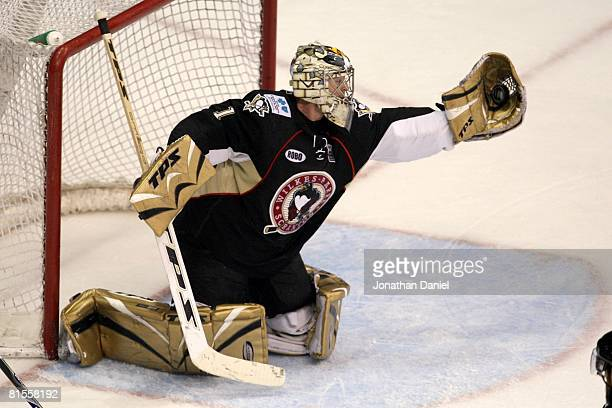 John Curry of the Wilkes-Barre/Scranton Penguins reaches for the puck against the Chicago Wolves during the Calder Cup Finals on June 10, 2008 at the...
