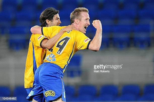 John Curtis of the Gold Coast celebrates his goal with Zenon Caravella during the round seven ALeague match between Gold Coast United and the...