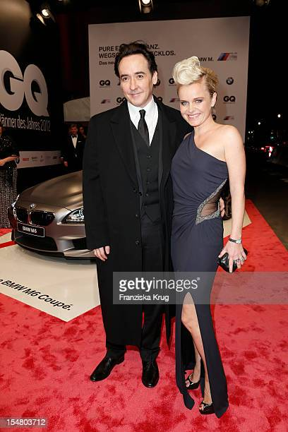 John Cusack and Barbara Sturm arrive at the 'GQ Maenner des Jahres 2012' at Komische Oper Berlin on October 26 2012 in Berlin Germany