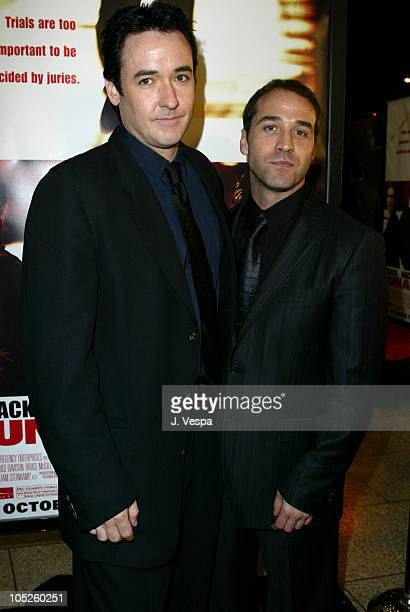 John Cusack and Jeremy Piven during Runaway Jury Los Angeles Premiere Red Carpet at Cinerama Dome in Hollywood California United States