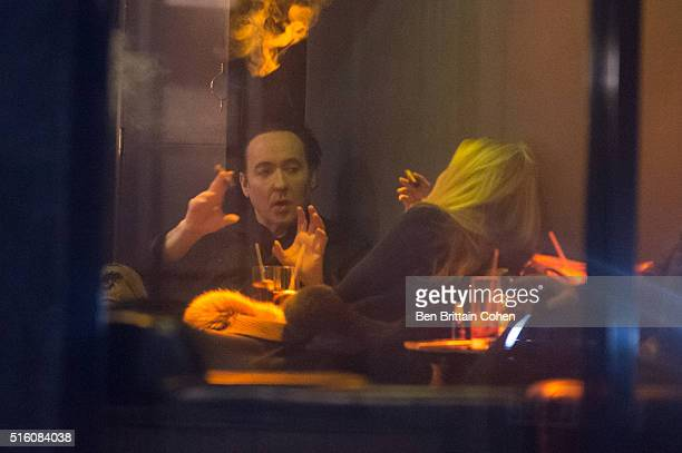 John Cusack is spotted out smoking cigars in a Cigar tasting bar in Soho London