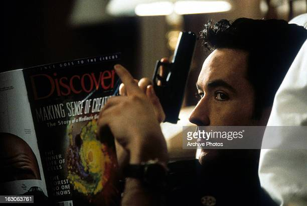 John Cusack reads a magazine in a scene from the film 'Grosse Pointe Blank' 1997