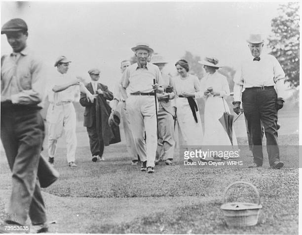 John D Rockefeller and group playing a round of golf at his Forest Hills Estate