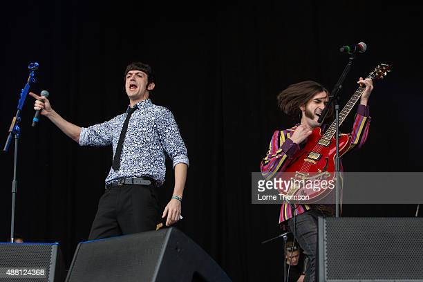 John Dagleish and George Maguire perform with the cast of Sunny Afternoon on the Main Stage at Blackheath Common on September 13 2015 in London...